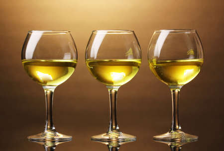 Wineglass on brown background photo