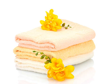 colorful towels and flowers isolated on white Stock Photo - 12979659