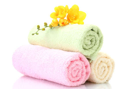colorful towels and flowers isolated on white Stock Photo - 12979608