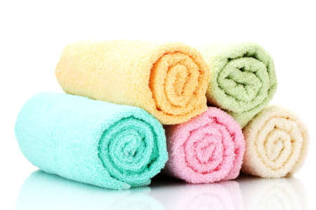 colorful towels isolated on white photo