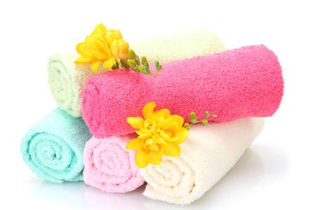 colorful towels and flowers isolated on white Stock Photo - 12979556
