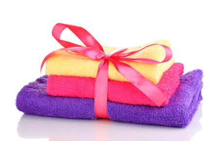 Colorful towels with ribbon isolated on white Stock Photo - 12979541