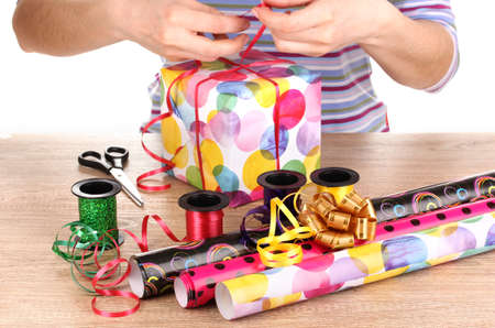 Wrapping presents surrounded by  paper, ribbon and bows Stock Photo - 12979483