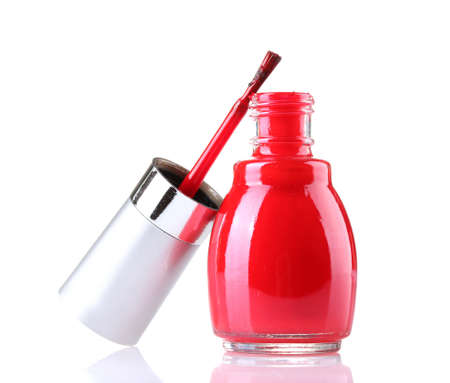red nail polish isolated on white photo