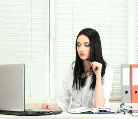 hospital stress: beautiful girl doctor in the office Stock Photo