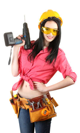 woman hard working: beautiful young girl-builder  holding drill isolated on white