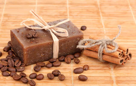 Hand-made soap on wooden mat photo