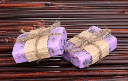 Hand-made lavender soaps on bamboo mat photo