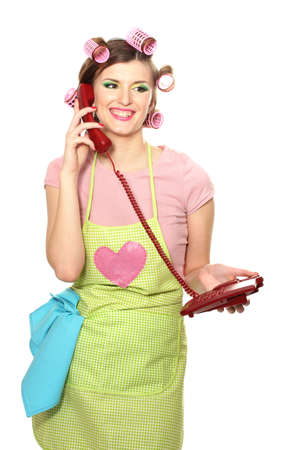 beautiful young housewife with red telephone isolated on white Stock Photo - 13446724
