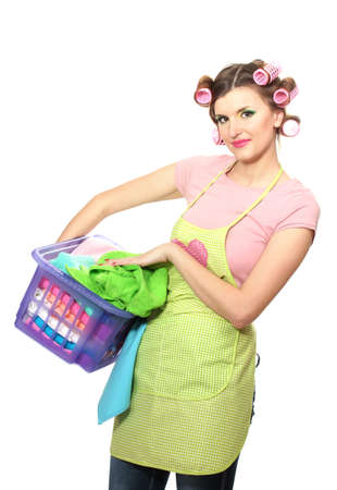 beautiful young housewife with basket of folded laundry isolated on white photo