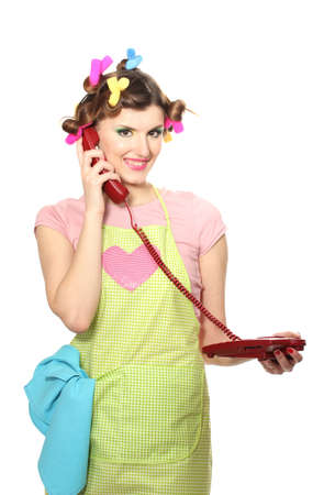beautiful young housewife with red telephone isolated on white Stock Photo - 13446652