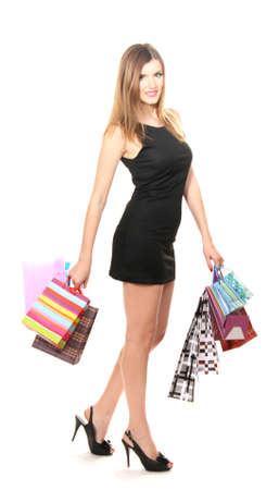 beautiful young woman with shopping bags isolated on white Stock Photo - 13446529