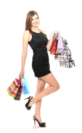 beautiful young woman with shopping bags isolated on white photo