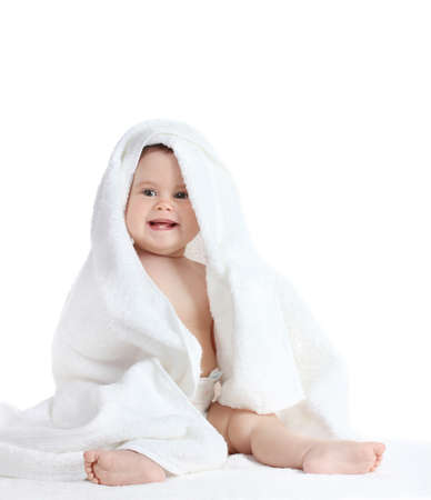 Cute baby girl with towel isolated on white photo