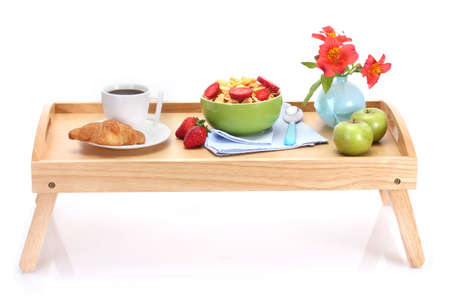 light breakfast on wooden tray isolated on white Stock Photo - 13026461