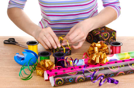 wrapping: Wrapping presents surrounded by  paper, ribbon and bows