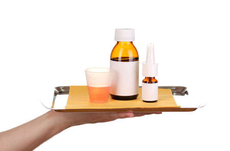 Hand holding tray with medicines isolated on white photo
