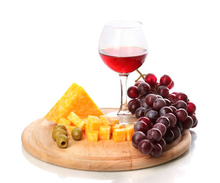 Wine in wineglass and cheese isolated on white