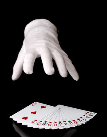 Cards and hand isolated on black photo