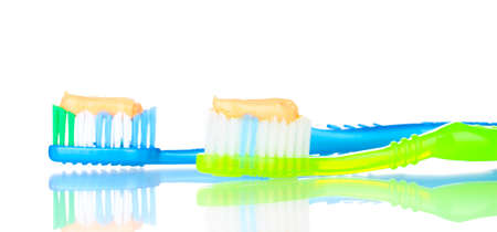 Toothbrushes with paste isolated on white photo