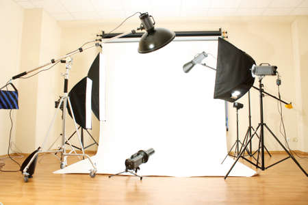 strobe: Empty photo studio with lighting equipment