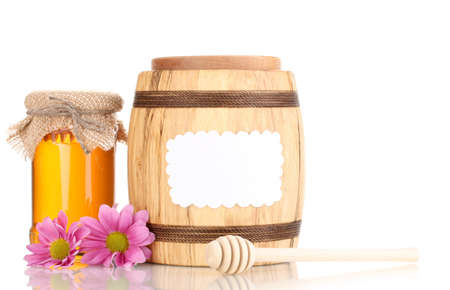 Sweet honey in jars and barrel with drizzler isolated on white photo