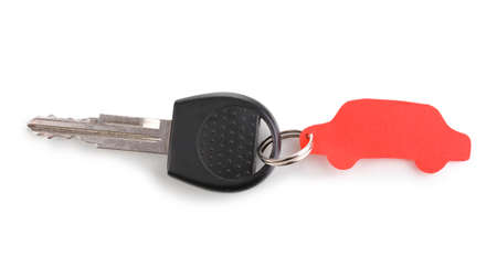 Car key with charm isolated on white photo