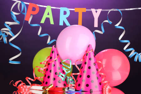 Party items on purple background photo