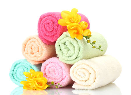 colorful towels and flowers isolated on white Stock Photo - 13052895