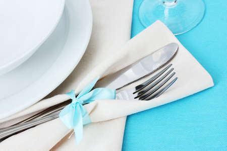 Table setting with fork, knife, plates, and napkin Stock Photo - 13061764