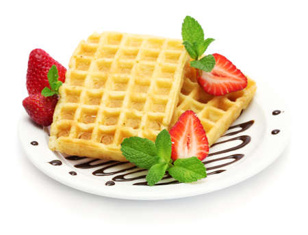 belgium waffles with strawberries and mint on plate isolated on white photo