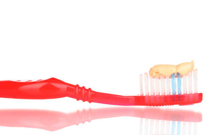 Toothbrush with paste isolated on white photo