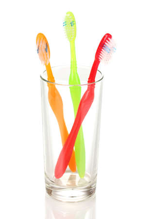 Toothbrushes in glass isolated on white photo