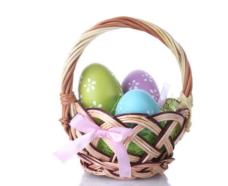 basket with Easter eggs isolated on white photo