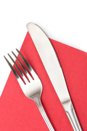 Fork and knife in a red cloth  isolated on white photo