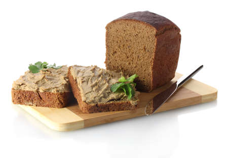Fresh pate on bread on wooden board isolated on white Stock Photo - 13099940