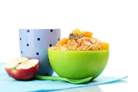 tasty cornflakes in green bowl, apple and glass of milk isolated on white photo
