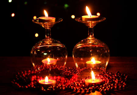 Amazing composition of candles on wooden table on bright background photo