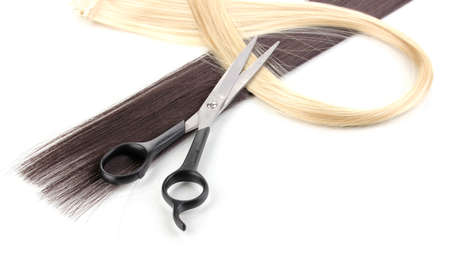 hair cut: Shiny blond and brown hair with hair cutting shears isolated on white Stock Photo