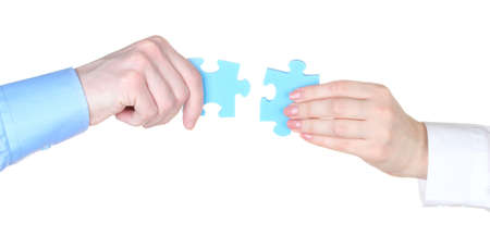 Hands with puzzle isolated on white Stock Photo - 13099512