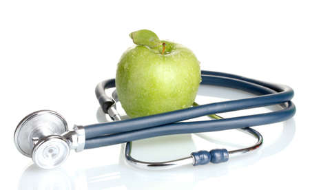 Medical stethoscope and green apple isolated on white photo
