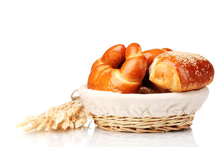 Baked bread in basket isolated on white photo