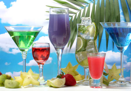 blue hawaiian drink: Glasses of cocktails on table on blue sky background