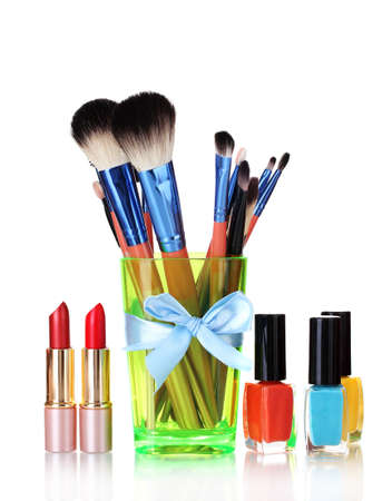make-up brushes in cup and cosmetics isolated on white Stock Photo - 13128876