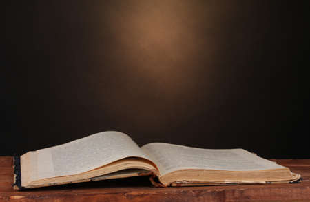 old book on wooden table on brown background Stock Photo - 13163111