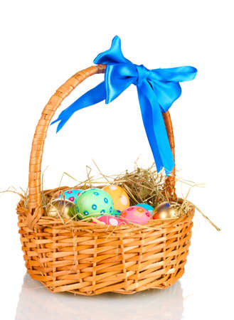 Colorful Easter eggs in the basket with a blue bow isolated on white Stock Photo - 13163104