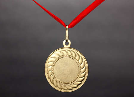 Gold medal on grey background Stock Photo - 13163246