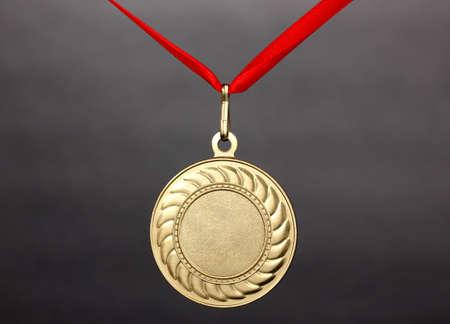 gold medal: Gold medal on grey background