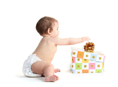 Cute baby girl and gift box isolated on white photo