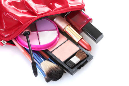 make up bag with cosmetics and brushes isolated on white photo